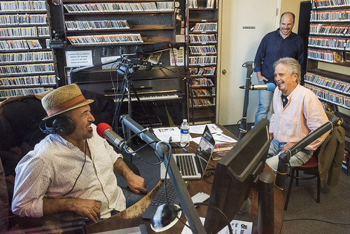 Marc Stone on the air with Spencer Bohren at WWOZ's 38th birthday - 12.4.18. Photo by Ryan Hodgson-Rigsbee rhrphoto.com. Scott Borne watches