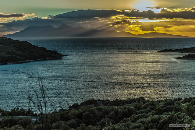 Morar Bay and the Isle of Rum, ablaze by the setting sun.