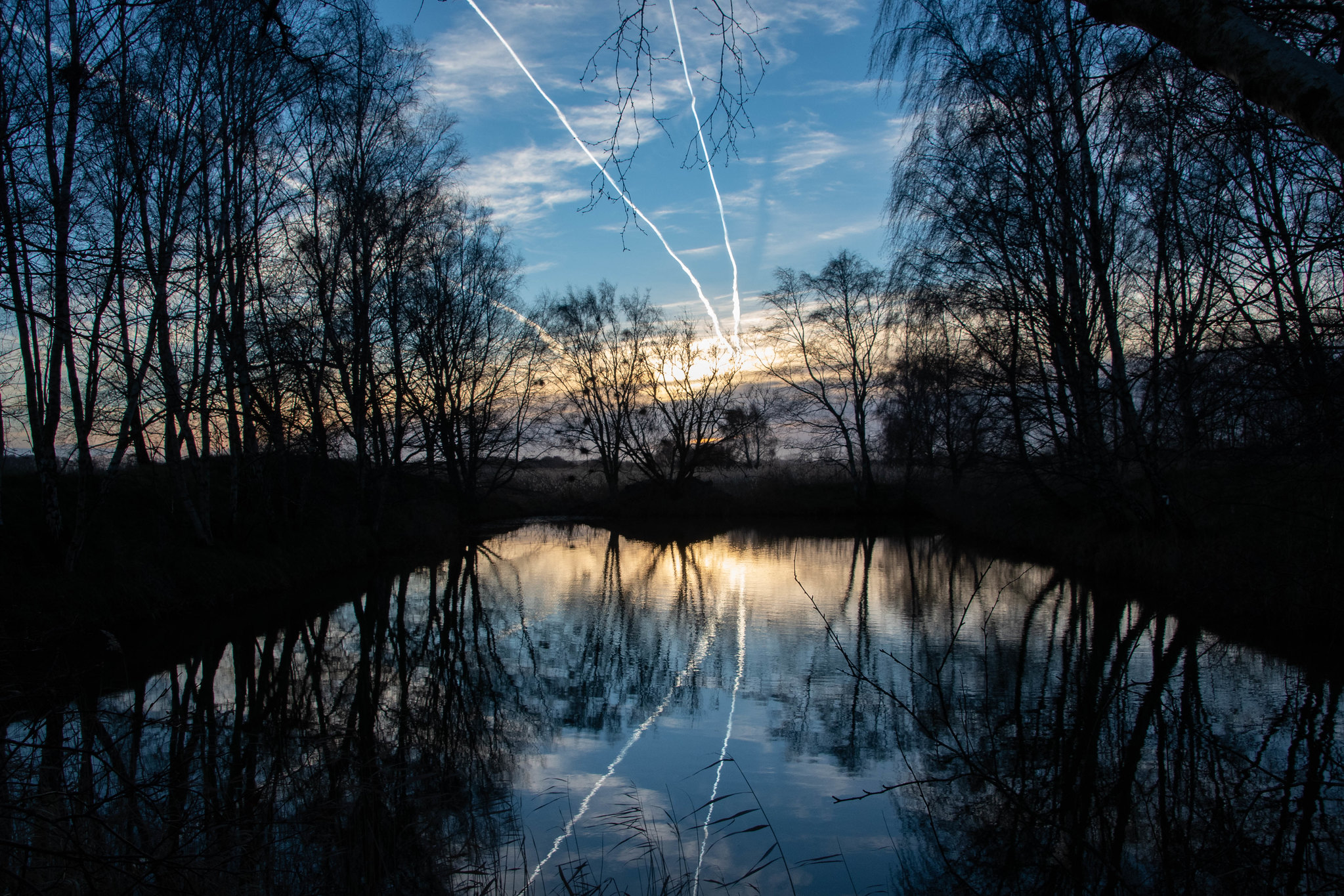 Flight tracks in sky and water.jpg