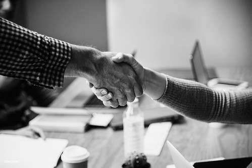 Business people shaking hands in agreement | by Rawpixel Ltd