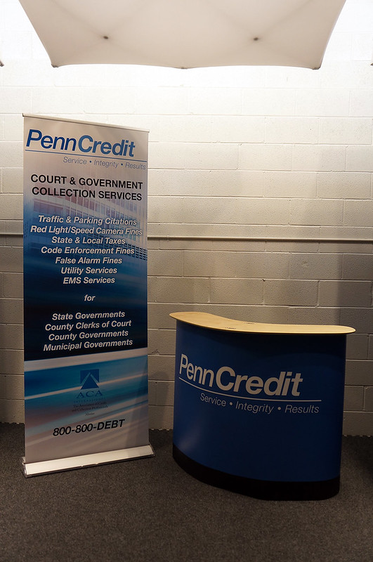 PennCredit Gov Banner and Podium