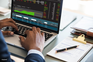 Black businessman using computer laptop | by Rawpixel Ltd