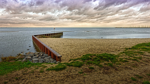 sea beach nature coastline outdoors sky water landscape cloudsky summer scenics woodmaterial nopeople blue pier sunset tranquilscene sand cloudscape seascape ijsselmeer