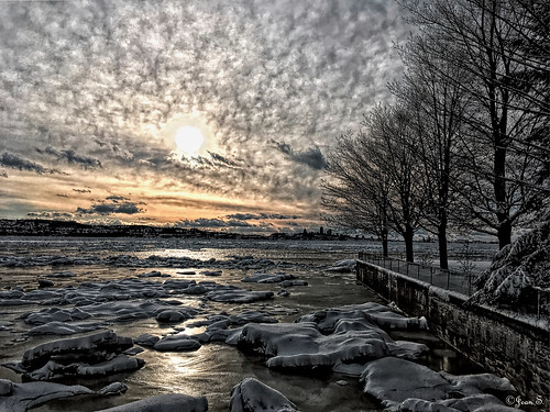 water river sunset clouds snow ice winter dock trees landscape island flickrunitedaward