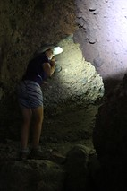 1285 Vicki uses her headlamp as she navigates around a dark corner in Slot Canyon Two in Sidewinder Canyon   by _JFR_