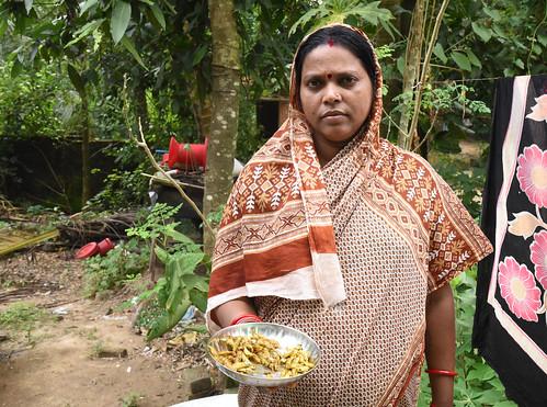 Urebashi Mallick holding fresh mola fried with turmeric, Gobindpur village, Kantapada block, Cuttack, Odisha, India. Photo by Arabinda Mahapatra.   by WorldFish