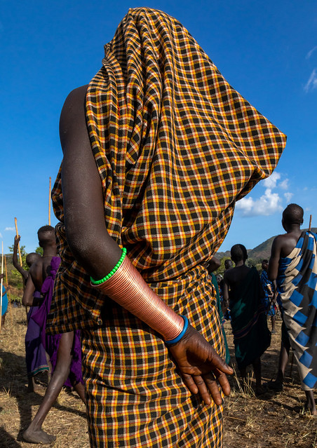 Rear view of a suri tribe woman during a donga ritual, Omo valley, Kibish, Ethiopia