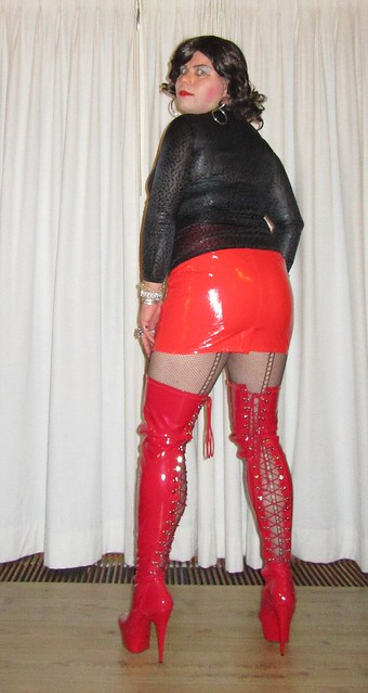 red boots and skirt with black cougar top