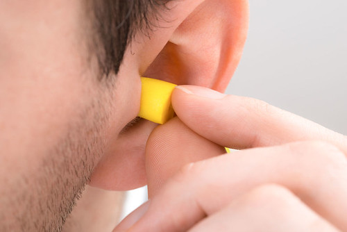Person Ear With Earplug | by umenumen17