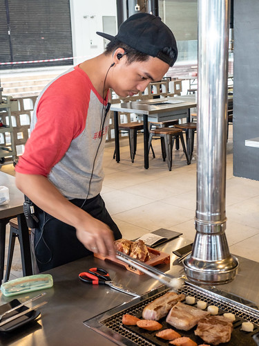 Staff at Apple Samgyupsal Jaya One barbecuing the meat, sausages and rice cake | by huislaw