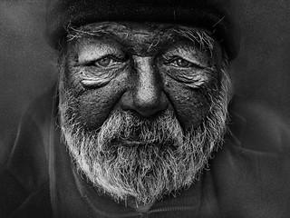 Elderly man in black cap