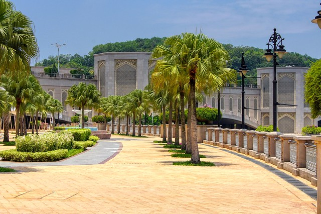 Promenade with palm trees at Putrajaya lake near Kuala Lumpur, Malaysia
