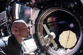 """Expedition 57 Commander Alexander Gerst of ESA (European Space Agency) peers out the International Space Station's """"window to the world"""" 