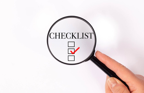 Checklist under magnifying glass | by wuestenigel