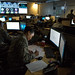 Cyber warfare operators serving with the 175th Cyberspace Operations Group of the Maryland Air National Guard at Warfield Air National Guard Base, Middle River, Md., monitor cyber attacks on the operations floor of the 275th Cyber Operations Squadron, known as the Hunter's Den, Dec. 2, 2017. (U.S. Air Force photo by J.M. Eddins Jr.)