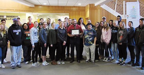 """Congratulations to @chrisjonesuw for being this month's Achieving Excellence Award winner! """"Professor Jones is willing to help students understand the work in ways that they can easily understand,"""" the student who nominated him wrote. """"He has encouraged m"""