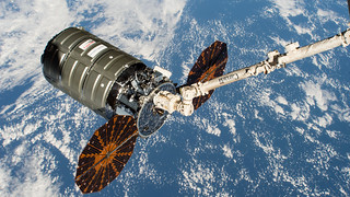 Northrop Grumman's Cygnus space freighter in the grips of the Canadarm2 | by NASA Johnson