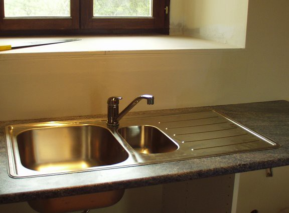 Kitchen sink plus tap