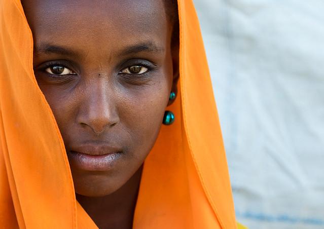 Portrait of an Oromo woman in orange veil, Amhara region, Senbete, Ethiopia