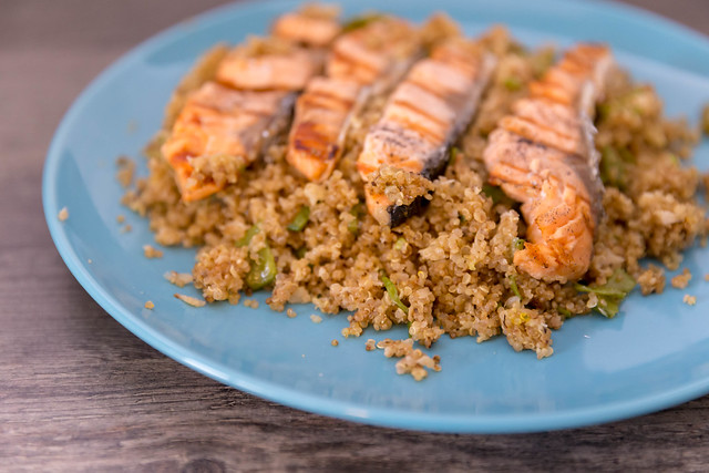 Roasted salmon strips on couscous, served on blue plate