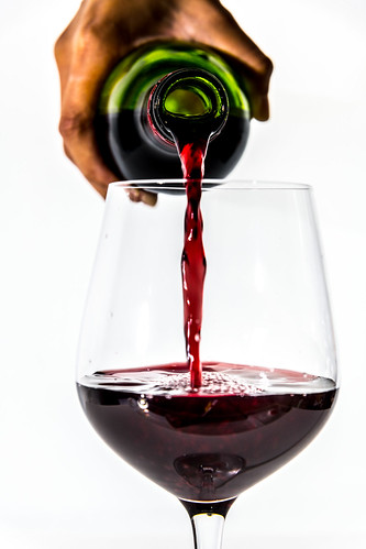 Pouring a glass of red wine | by Rawpixel Ltd