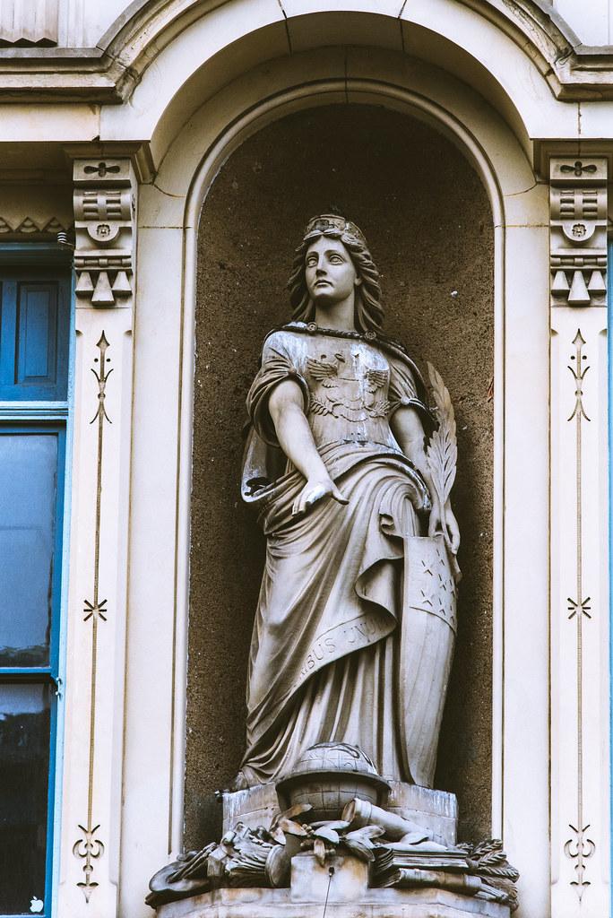 A statue in a building facade