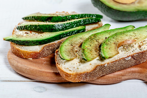 Healthy avocado sandwich with cheese and dark bread