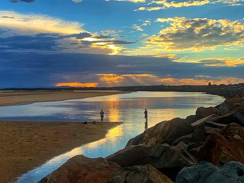 water beach fishing sunset