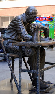 """""""Needle Treading a Button"""" sculpture on 7th Avenue, New York."""