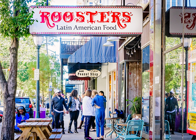 Tourists and restaurant signs on Dauphin Street in downtown Mobile Alabama