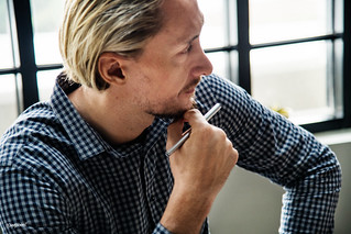 Blond man busy at work | by Rawpixel Ltd