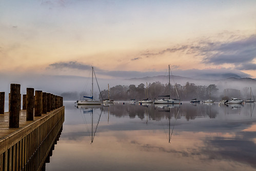 ambleside england unitedkingdom gb hills hill mountain moutains mist fog boat sailing pier reflection reflections sunrise clouds landing stage landscape