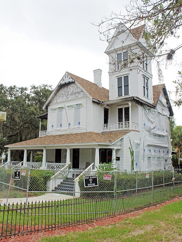 architecture house historical victorian tower shrubs fence lawn trees ruin firedamage leesburg florida unitedstates