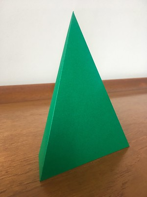 Photo of a green triangle of paper