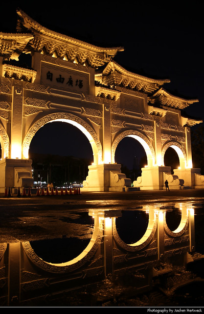 Liberty Square Main Gate Reflected in a Rain Puddle at Night, Taipei, Taiwan