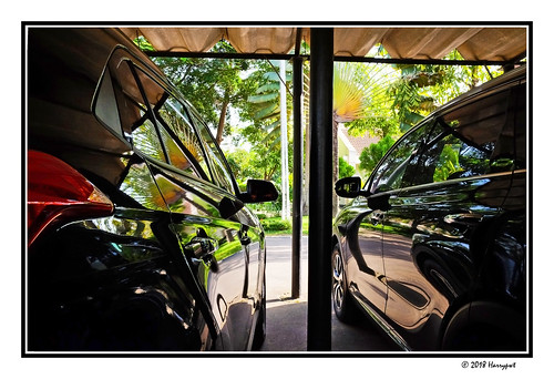 harrypwt nigeria fujix70 x70 borders framed abuja maitama backyard cars trees reflections