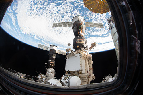 Russian spacewalker Oleg Kononenko attached to the Strela boom   by NASA Johnson