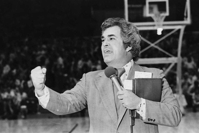 Evangelist Bob Harrington preaches a sermon during half-time at a Spurs-Pacers game on April 10, 1974.