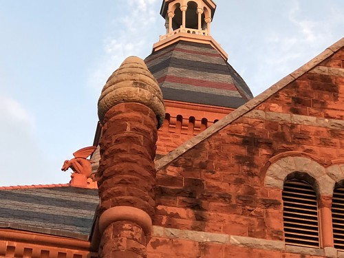 red museum dallas brick stone gargoyle tower roof blue sky texas