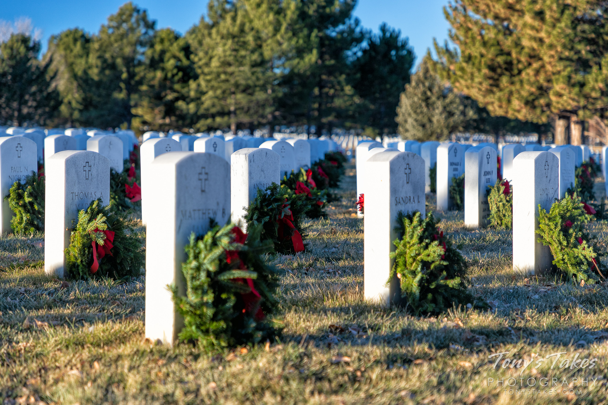Wreaths adorn the graves of veterans at Fort Logan National Cemetery in Colorado. (© Tony's Takes)