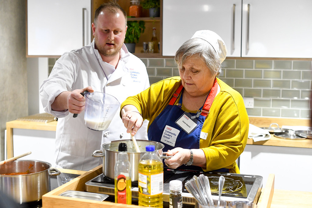 Tesco Community Cookery School with Jamie Oliver Teaching over 1,000 community cooks how to stop good food going to waste