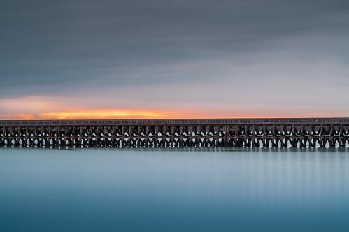 sunset sunrise longexposure pier newhaven sussex photography landscape uk landscapes sussexlandscapes seaside beach sand water clouds overcast