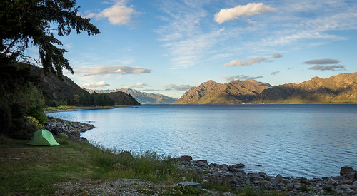 lakehawea newzealand otago southisland southernalps campground camping cloud grass lake lakeshore landscape moon mountains panorama rockyshore sky sunset tent