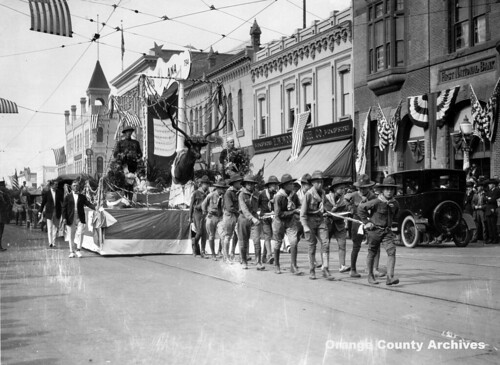 Boy Scouts pull Elks float down 4th St. in Armistice Day Parade, Santa Ana, 1920s | by Orange County Archives
