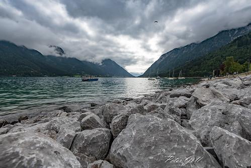 ebenamachensee tirol österreich at rock lake mountain alpen alps water sky clouds wolken