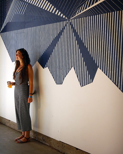 Matching one's outfit to a striped mural on Granville Island, Vancouver
