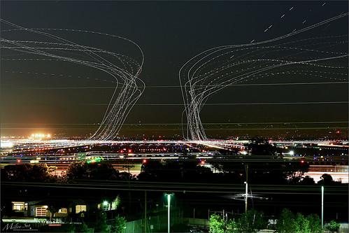 sfo longexposure dusk california sky evening nightphotography nightscene traffictrails traillights airplane aircraft house sanfranciscointernationalairport airport