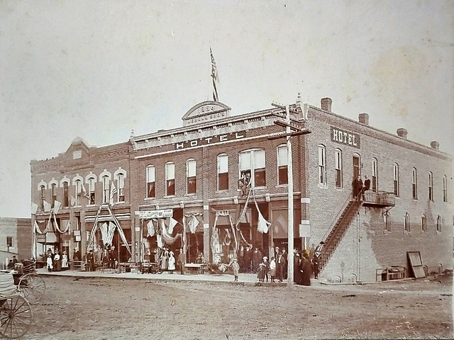 S side of Pville Sq decod for July 4 mid store AE Stevens furniture with Mr n Mrs Stevens in front and Mrs Grace Stevens Stringfellow
