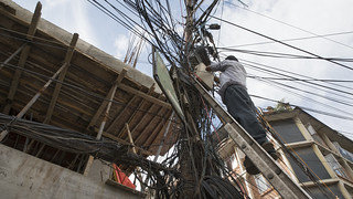 Electrician Works on Power Lines | by World Bank Photo Collection