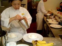saucing the cheesecake